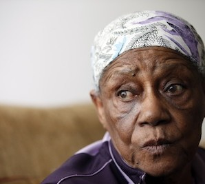 Levant Graham, 84, speaks during an interview in her apartment, Friday, Oct. 23, 2015, in Washington. Graham was forced out of her previous home by District of Columbia Housing Authority, and that house now stands vacant. The District of Columbia Housing Authority is moving aging tenants out of homes where they've lived for decades, renovating them and selling them to wealthy buyers. (AP Photo/Alex Brandon)